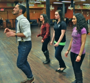 Val Chmerkovskiy of Dancing with the Stars works with LSY! team members Francesca Harvey, Bryanna Gwitt and Narmeen Karzoun at his New York City studio, Dance With Me.(Photo by Tim O'Shei)