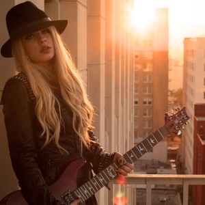 "Orianthi has had a worldwide hit (""According to You"") and has played with a long list of superstar musicians, from Michael Jackson to Carrie Underwood to her current gig with Alice Cooper."