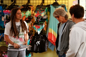 Jason Castro, left, plays a surf shop owner in UP TV's The Perfect Summer. Eric Roberts, middle, plays a grandfather who's also a legendary surfer. (Photo courtesy of UP TV.)