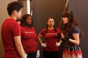 """Jess (Zooey Deschanel, right) prepares the members of her handbell quartet (Ki Hong Lee, Raven Goodwin and Esther Povitsky) to perform in the """"New Girl"""" episode of Glee on Fox. (Greg Gayne's photo courtesy of Fox Broadcasting Co.)"""