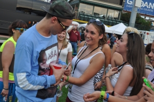 Sammy Adams signs autographs for fans at PXY's Summer Jam in Rochester, New York. (Photo by Tim O'Shei)
