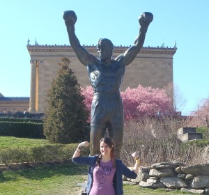 "Graceanne Rumer in front of Philadelphia's ""Rocky"" statue."