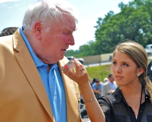 John Madden, here with Hailey Rose Gattuso on the steps of the Pro Football Hall of Fame, says that surrounding yourself with greatness is the key to being great yourself. (Photo by Lauren Kirchmyer)