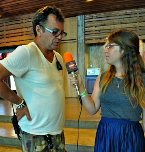 Vans Warped Tour founder Kevin Lyman, with LSY reporter Mary Hartrich, says he loves his daughter Sierra's work ethic. (Photo by Tim O'Shei)