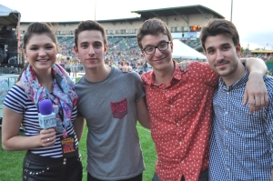 Jessica Wojcinski with the guys of AJR – Jack, Ryan and Adam – at the 98PXY Summer Jam in Rochester, New York. (Photo by Tim O'Shei)