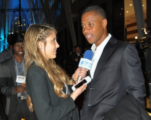 Cuba Gooding Jr., a longtime hockey fan and recreational hockey player, is inspired by the game's great athletes. Here he talks to Hailey Rose Gattuso at the Hockey Hall of Fame in Toronto. (Photo by Michelle Ostrander)